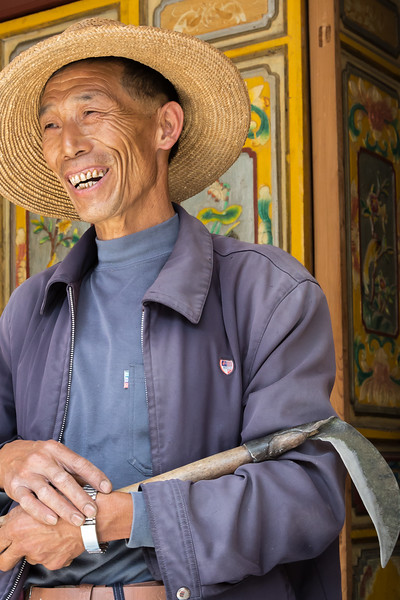 A farmer in Zhou Cheng, China, is delighted to welcome visiting photographers into his courtyard.