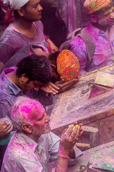 Even while drenched in color, these celebrants demonstrate the reverent side of Holi, as well.