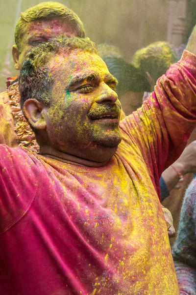 A Holi participant in a Vrindavan temple seems to radiate both ordinary human happiness and spiritual bliss.