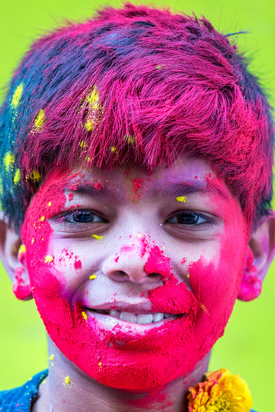 A teenager in Vrindavan, India, has thoroughly enjoyed the color immersion of Holi.