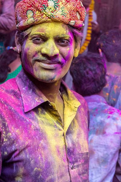 A paint- and powder-splashed Holi celebrant in Vrindavan, India.