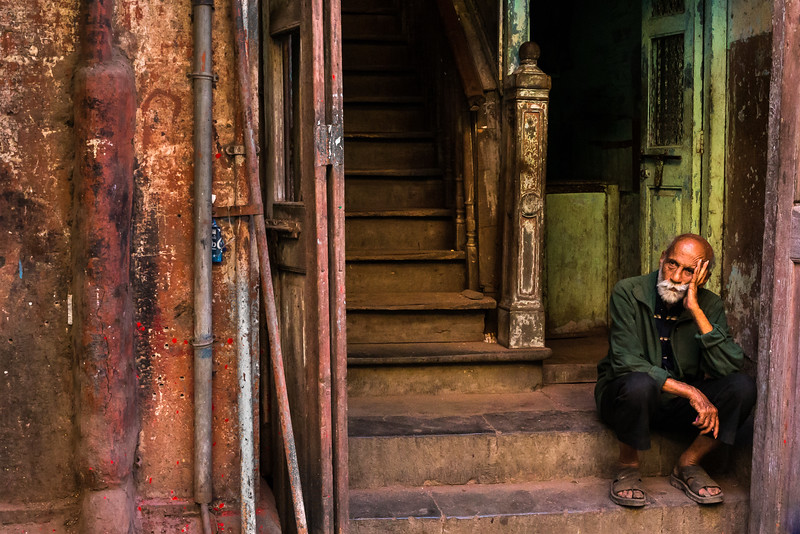 Even on a bustling downtown street in Mumbai,, the most populous city in India, this man enjoys a moment of quiet reflection.