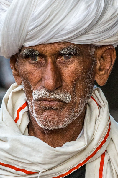 Jodhpur, India. A member of the 500-year-old Bishnoi social group visits the city from the nearby desert. Bishnoi are Thar desert dwellers with religious tenets that require environmental sensitivity, including the protection of all life forms.