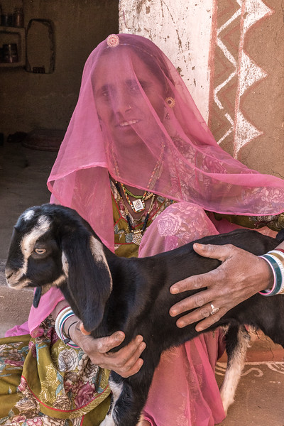 Rajasthan, India. This woman's colorful clothes and a well-cared-for goat belie the stark Thar desert landscape of this part of India.