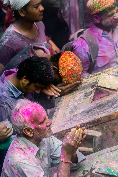 Vrindavan, India. Though covered in multi-colored powders and paints, these Holi worshipers have a spiritual focus.