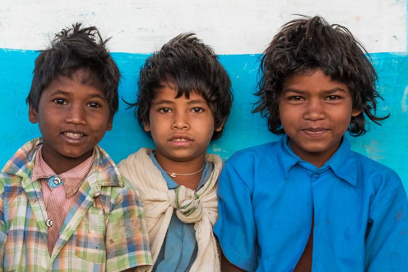 Benda, Bhoramdeo, Chhattisgarh, India. Baiga boys are happy to pose for a photographer.