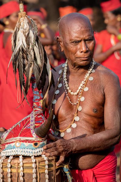 Naener, Baster, Chhattisgarh, India. An elderly Bison Horn dancer takes a break.