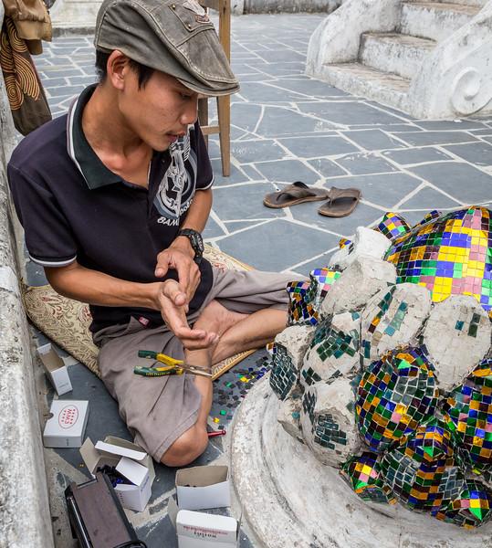 Luang Prabang, Laos. Restoration work on a part of Wat Xieng Thong, a jewel among Luang Prabang's dozens of temples.