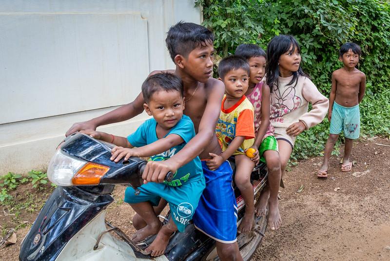Prek Bang Kong Village, Cambodia. Five village children squeeze onto a motor scooter.