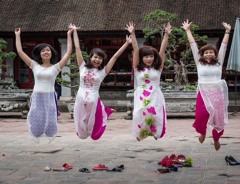 Temple of Literature, Hanoi, Vietnam. Ao dai clad students celebrate their graduation in the third courtyard of the Temple of Literature.
