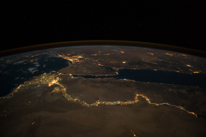 Over human history people have often settled along waterways like this famous river and its delta. ISS over Africa. (ANSWER: The Nile River)