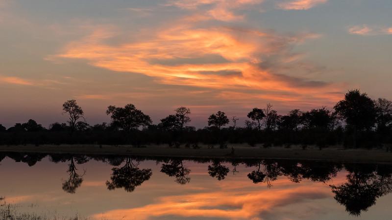 Selinda, Okavango Delta, Botswana. A spillway sunset.