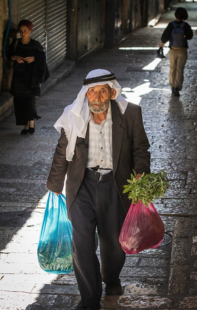 Old man does his shopping before the rush