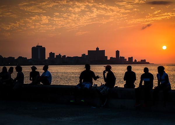 Locals enjoying the sunset along the Malecon - Havana, Cuba