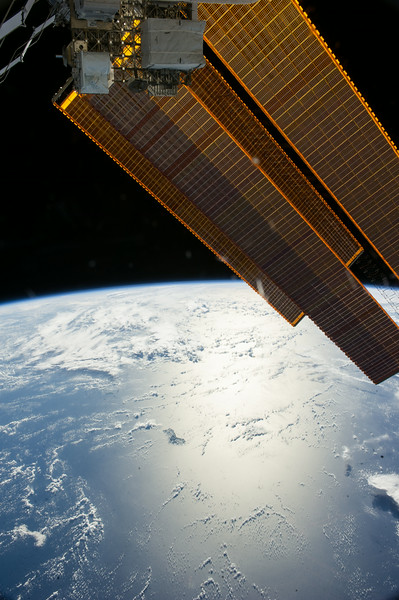 Reid Wiseman: Good night from the ISS.  Solar arrays glisten approaching Australia.