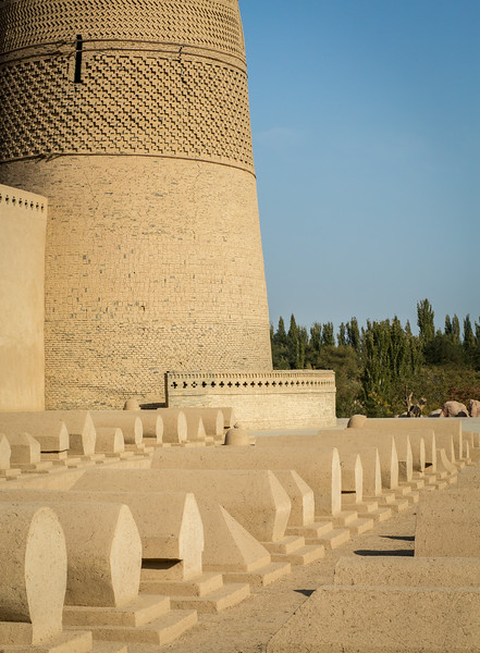 Emin Minaret and Mosque, Turpan, China; with the distinctive Uyghur style of cemetary in the foreground
