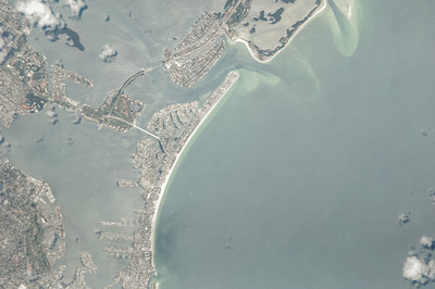 Caption by Space Station Academy student: The Keys and beach features extending West into the Gulf of Mexico from the metropolis of St. Petersburg, FL., USA.  Note the apparent fragility of the various and interconnected keys and sandbar regions. Hurricanes and sea-level rise can damage and destroy regions such as this. From images like this, people can monitor and realize the susceptibility of living adjacent to, and in, ocean areas and take action to mitigate the dangers.