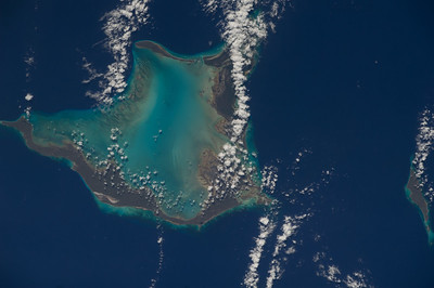 Caption by Space Station Academy student: This is a beautiful image of Crooked Island, one of numerous islands in the Bahamas.  Imagery of the Bahamian islands and atolls always fascinates me.  It is a bit difficult to tell which land is entirely above the water and which land is slightly below it.  The clarity of the waters in the Caribbean must enhance this effect.  I once had to do a mapping/charting project on the Bahamas, and I noticed this same effect while looking at many of the islands. Studying images such as these, over a period of time, we may see significant differences as sea levels rise.  This also applies to other small island nations throughout the world.  I wonder how the rising sea levels will affect the drawing of legal maritime boundaries for such countries.