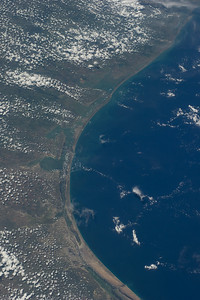 Caption by Space Station Academy student: This image shows the coast of the Gulf of Mexico.  The water is greener closer to the coast, where it is a bit warmer and shallower.  There are beaches and fertile land just to the west of these.  The contrast between the colors on land and over the water are dramatic.  Most of the land area looks to be desert or sand and the cast area of water is primarily a deep blue color.  The land in this picture does not look overly built up from this angle.