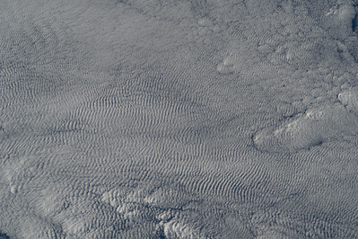 Caption by Space Station Academy student: It appears to be a layer of clouds over the ocean. The pattern of the clouds seem to be bumpy and similar to desert sands.  I chose this image because it looked unique to me. I have seen different cloud formations, but I've never seen clouds form like this. The clouds looked like a sheet of metal at first glance.
