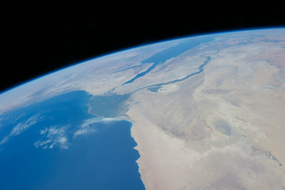 Caption by Space Station Academy student: Picture showing the Nile River Delta and Faiyum Oasis. There is vegetation because of the river. The hearty shaped green place is the Faiyum Oasis.