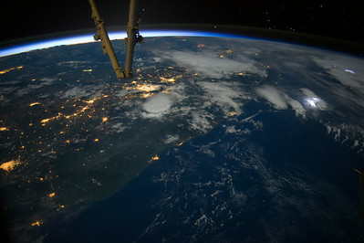 Captions by 2cSpace Station Academy student:  1) This is a picture of Mexico with different kinds of vibrant lights: man made lights, (city lights), galaxy lights ( star lights) and storm lights (lightning). In this picture I love how there are three different kinds of lights in the same picture! With this photo people study how they look from space and compare their differences.                              2) This is a picture of a mix of a lot of different things.  There is a thunderstorm in one area and a city in another.  The gold colors are city lights.  The bright flashes in the clouds that look like camera flashes are lightening. You have a good view of the horizon line with the thin layer of the atmosphere showing up with the sun.  You can also see part of the ISS. I like this picture because it was a night picture and I love night pictures.  I like that you can see a lightening storm over the water and cities lit up on the land.  The horizon is beautiful and there are so may bright spots in this picture!!