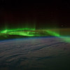 Caption by Space Station Academy student: This photo shows an aurora over Antarctica and is taken along the southwestern corner of Australia facing toward Antarctica, as evidenced by the sheets of ice below.  Stars are also in the picture.  The photo is a beautiful night view of a clear sky with an aurora dancing across it.