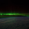 Caption by Space Station Academy student: This is a green aurora light over Antartica. It is currently night in this area, so the light is clearly visible. I chose this image because it first caught my eye while I was looking through the photos.