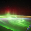 Caption by Space Station Academy students: 1) This is a picture of the Aurora Australis or Southern Lights.  You can see the lights of all different colors dancing up and down and you can also see part of the space station.  Beyond that you can see the thin atmosphere of Earth.  The white color underneath the lights is snow and you can see a little bit of blue and that's the melted snow.  You can see the Southern Lights dancing up and down.  I like how it seems like the lights are having a contest to see how high they can go.  I also think it's cool that you have a pretty good view of the Earth's atmosphere.   It's very thin and the lights seem to go through the atmosphere.             2)  It looks as if the sun is rising and the northern lights are still going and finishing up for the night. There is a beautiful reflection off of the atmosphere and a the beautiful green northern lights. 3)  This image is the Aurora Australis or southern lights, the southern hemisphere's version of Aurora Borealis. Not only do the green lights swirl majestically and become red as they retreat from Earth, but the stars can be seen as well as the horizon of light, creating a spectacular visual array of colors set off by the night sky on one side, the earth on the other.<br /> <br /> 4) This photograph was taken at such an angle as to capture both the earth below and the stars above. There is a powerful otherworldliness in seeing the night's sky as one would see it from on earth, the earth itself as seen from space, and the stunning light show in between  5) The aurora is a beautiful and benign aspect of more dangerous space weather.  Space weather must be monitored for the safety and health of astronauts, to protect satellites and Earth's power grids. The space perspective helps people better understand Earth's relationship with the sun.