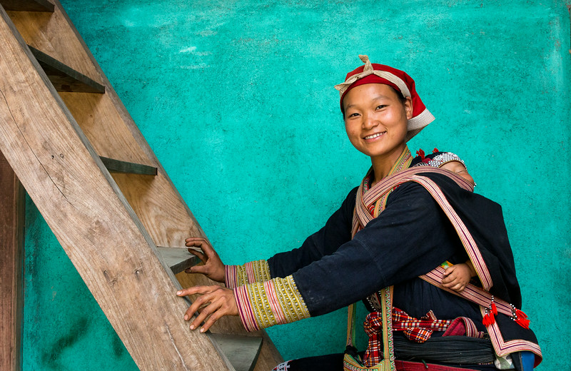 Ta Phin, Sapa, Vietnam: Red Dzao woman and child. Sapa, in mountainous far northern Vietnam, is home to numerous colorful hill tribes and steeply terraced rice fields.