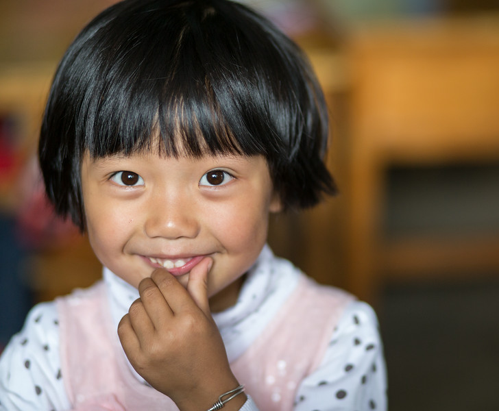Shaping, China: a kindergarden student not quite ready to return to her studies after recess