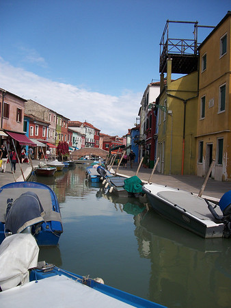 The many coloured houses of the island of Burano, each house is privately owned and painted as the same colour as the family fishing boat