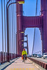 Touring cyclist on Golden Gate Bridge, California - 4-Edit - 72 ppi