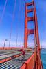 Biker commuting across Golden Gate Bridge in California - 2-Edit - 72 ppi