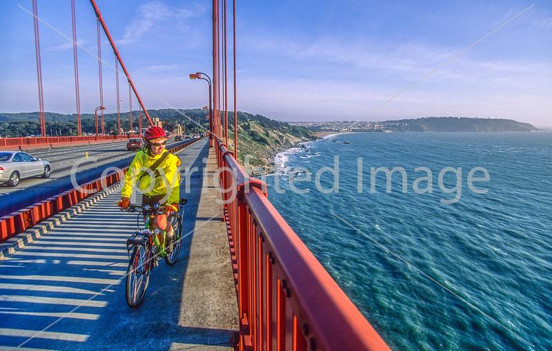 Biker commuting across Golden Gate Bridge in California - 1-Edit - 72 ppi
