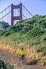 Mountain biker above Slide Ranch in Golden Gate National Recreation Area in California - bridge in view - 7-Edit - 72 ppi