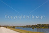 Biker on plantation road along Grant's Route in Louisiana - D2-C3  -0008 - 72 ppi