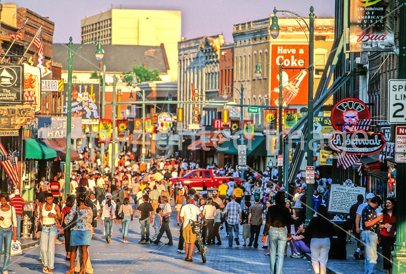 Cyclist on famed Beale Street in Memphis, Tennessee, as it comes alive on a Saturday evening - 72 ppi