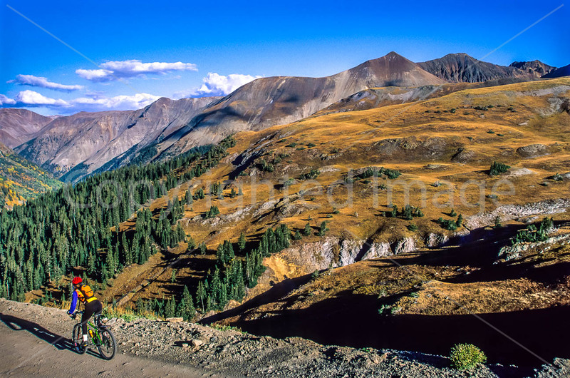 Mountain biker on Colorado's Alpine Loop - Lake City to Engineer Pass in San Juan Mts  - 26 - 72 ppi