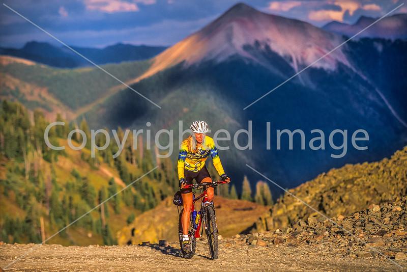Biker at or near Ophir Pass on Colorado's Alpine Loop, between Silverton & Telluride - 63-Edit - 72 ppi