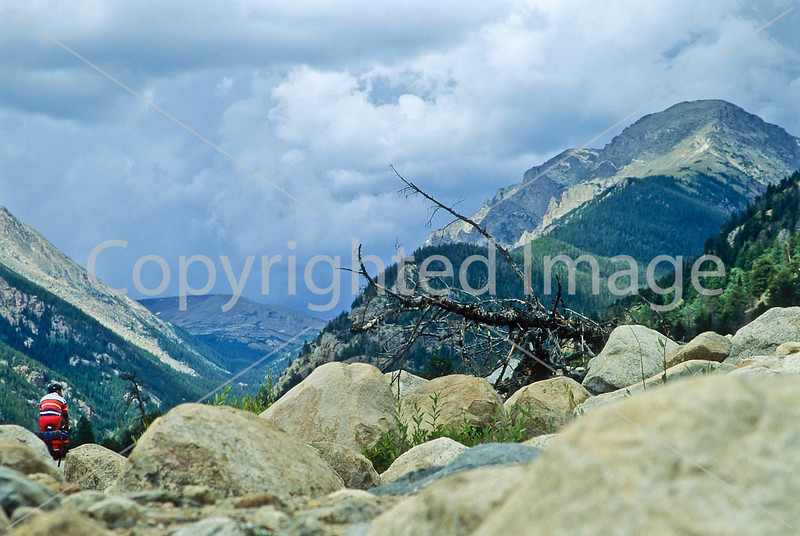 Cyclist approaching Old Fall River road in Colorado's Rocky Mountain National Park - 7 - 72 ppi
