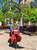 Touring cyclist in Bienville Square in downtown Mobile, Alabama - mobi0045 - 72 ppi