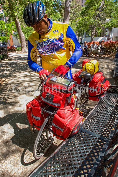 Touring cyclist in Bienville Square in downtown Mobile, Alabama - mobi0010 - 72 ppi