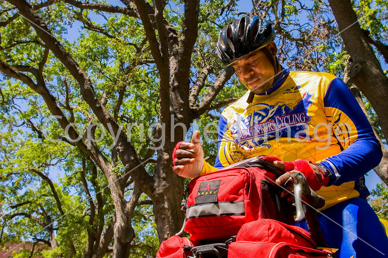 Touring cyclist in Mobile, Alabama's Bienville Square - mobi0084 - 72 ppi