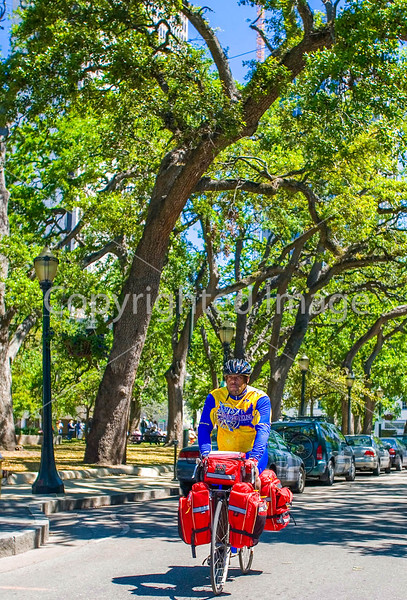 Touring cyclist in Mobile, Alabama; near Bienville Square_mobi0113 - 72 ppi