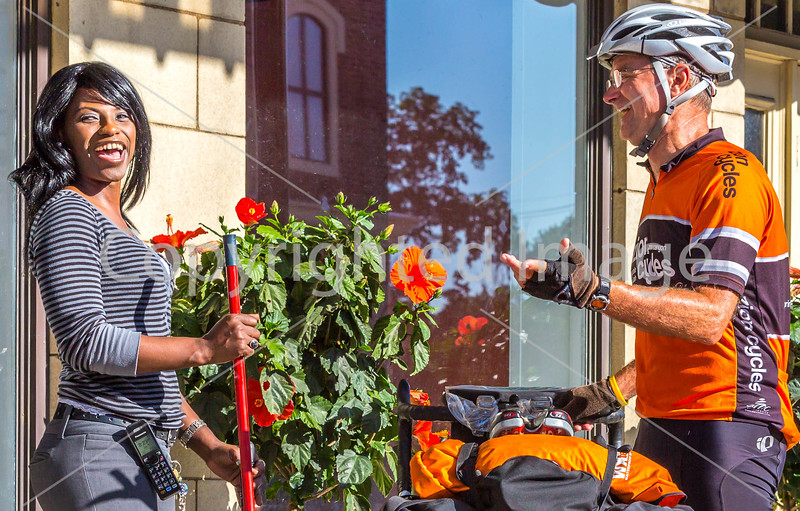 ACA - TransAm rider John Beck in downtown Chanute, KS, chatting with local Jackie Moore - C1-0472 - 72 ppi-2