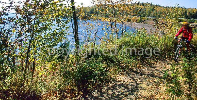 Biker on Minnesota's Gitchi-Gami State Trail on Lake Superior's western shore, near Split Rock Lighthouse - 3-Edit - 72 ppi-2