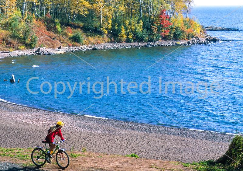 Biker on Minnesota's Gitchi-Gami State Trail on Lake Superior's western shore, near Split Rock Lighthouse - 1 - 72 ppi-2