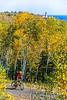 Biker on Minnesota's Gitchi-Gami State Trail on Lake Superior's western shore, near Split Rock Lighthouse - 4-Edit - 72 ppi