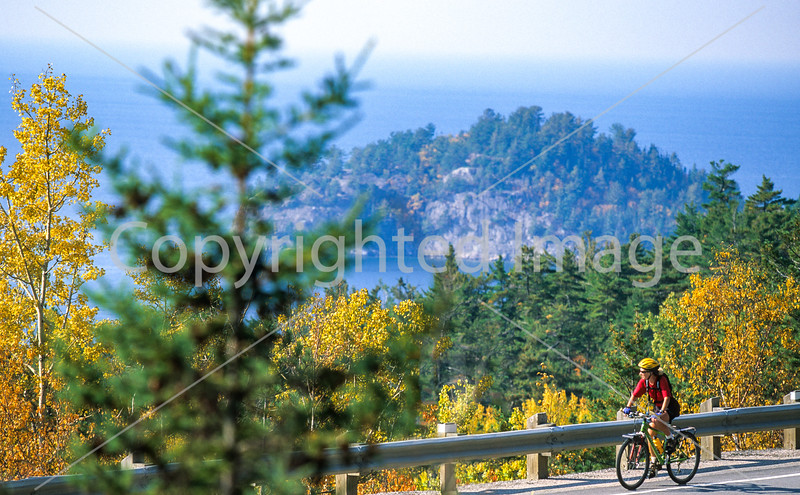 Biker on Canada's Hwy 17 (Trans-Canada Hwy) in Lake Superior Provincial Park north of Sault Ste  Marie - 2-Edit - 72 ppi